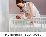 portrait of a beautiful mother... | Shutterstock . vector #626969060