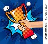 hand holding gold trophy. we... | Shutterstock .eps vector #627016160