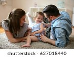 happy family lying on floor... | Shutterstock . vector #627018440