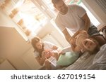 family playing with their two... | Shutterstock . vector #627019154