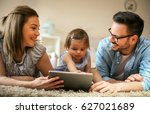 family lying on the floor with... | Shutterstock . vector #627021689