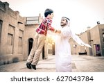 arabic family playing with child | Shutterstock . vector #627043784