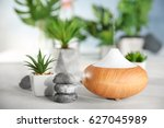 oil diffuser on blurred... | Shutterstock . vector #627045989