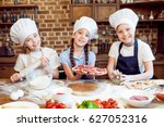kids in chef hats making pizza... | Shutterstock . vector #627052316