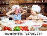 kids in chef hats having fun... | Shutterstock . vector #627052364