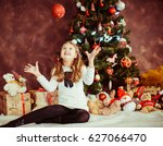 girl plays with red sparkling... | Shutterstock . vector #627066470