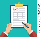 man hand hold tax form and hand ... | Shutterstock . vector #627089600