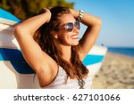 beautiful young woman relaxing... | Shutterstock . vector #627101066