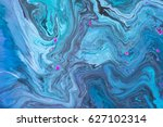 Small photo of Abstract artistic photograph of a staged action painting scene. Liquid Colors ink drops paint depth. Colorful blend in blue color tones.