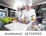 chefs cooking  cutting and... | Shutterstock . vector #627145310