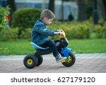 little boy ride toy motorcycle... | Shutterstock . vector #627179120