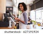 portrait of waitress at cash... | Shutterstock . vector #627191924