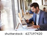 businessman using phone whilst... | Shutterstock . vector #627197420