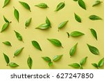 flat lay green leaves pattern.... | Shutterstock . vector #627247850