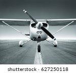 sports plane on a runway | Shutterstock . vector #627250118