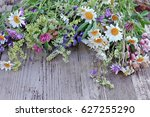 wild flowers bouquet on wooden  | Shutterstock . vector #627255290