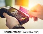 hand swiping credit card in... | Shutterstock . vector #627262754