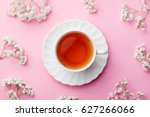cup of tea with fresh flowers... | Shutterstock . vector #627266066