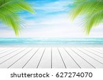 empty wooden table and palm... | Shutterstock . vector #627274070