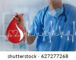 big blood drop with heart pulse ... | Shutterstock . vector #627277268
