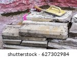Small photo of curb curb with lying repair tools, trowel, paint brush for
