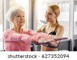 beaming retiree making workout... | Shutterstock . vector #627352094