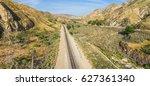 Railroad Tracks Run Through A...