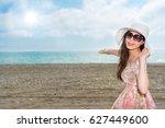 happy asian woman making... | Shutterstock . vector #627449600