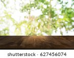 wood table top and blur of...   Shutterstock . vector #627456074