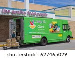 A Green Peapod Truck Parked...