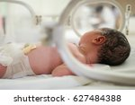 new born infant baby asleep in... | Shutterstock . vector #627484388
