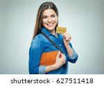 smiling woman shows credit card.... | Shutterstock . vector #627511418