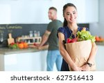 young couple in the kitchen  ... | Shutterstock . vector #627516413