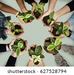 Small photo of Diverse people plant environment