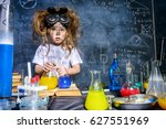 Stock photo funny little girl doing experiments in the laboratory explosion in the laboratory science and 627551969