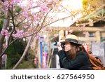 tourist photographer is... | Shutterstock . vector #627564950