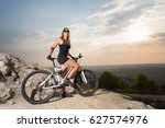 sporty woman cyclist on a...   Shutterstock . vector #627574976