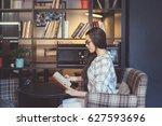 attractive woman reading book... | Shutterstock . vector #627593696