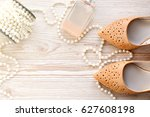 woman shoes  perfume and beads... | Shutterstock . vector #627608198