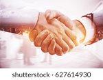 close up of handshake on... | Shutterstock . vector #627614930