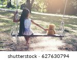 sad child sitting with teddy... | Shutterstock . vector #627630794