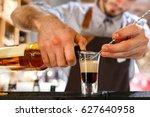 bartender prepares b52 shot   Shutterstock . vector #627640958