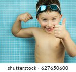 kid boy at swimming pool. | Shutterstock . vector #627650600