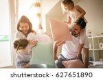 family having funny pillow... | Shutterstock . vector #627651890