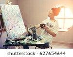 female artist working on...   Shutterstock . vector #627654644