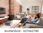 family sit on sofa in open plan ... | Shutterstock . vector #627662780