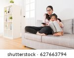 asia mom and daughter watching... | Shutterstock . vector #627663794
