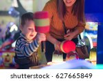 little child play with arcade...   Shutterstock . vector #627665849