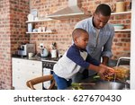 son helping father to prepare... | Shutterstock . vector #627670430