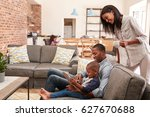 father and son sit on sofa in...   Shutterstock . vector #627670688